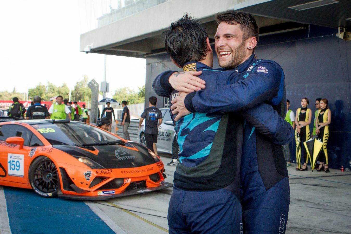 Jono Lester celebrates victory with Akihiro Asai