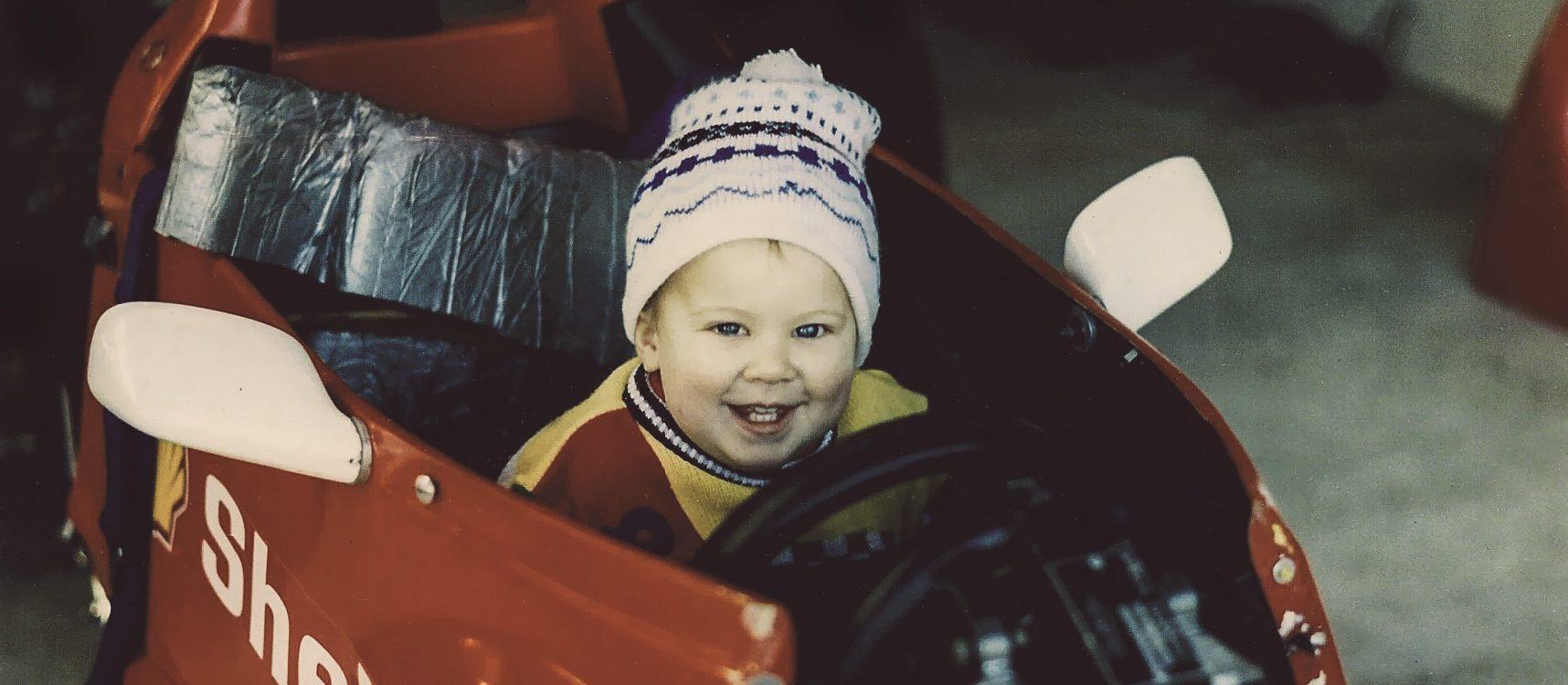 Jono Lester as a bady, sitting in a Formula Ford race car