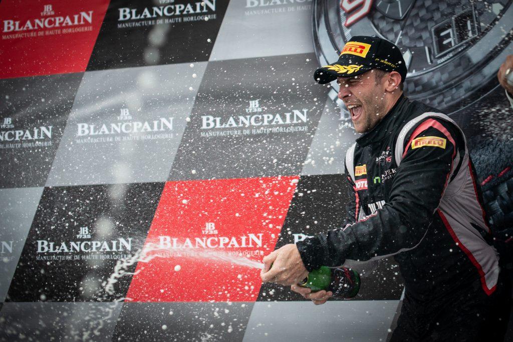Jono Lester sprays champagne
